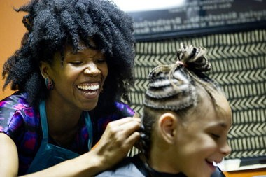"""Amber Starks (left), who is fighting to change state law to allow hair braiders to work without earning a full cosmetology license says: """"Braiding can be a way for women to start to get comfortable with wearing their hair naturally. That's what it was for me."""" Braiders typically do not use chemicals, heat or scissors, thus practitioners say they should not be required to go through the 1,700-hour training required of cosmetologists. For now, Starks offers advice in Oregon but does her actual braiding -- on customers such as 7-year-old Zinnia Rickman -- at a salon in Vancouver."""