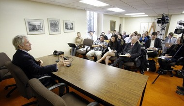 In a state Capitol meeting room, Gov. John Kitzhaber talks to reporters and newspaper editors about his goals for the upcoming legislative session.