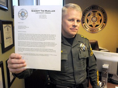 Linn County, Sheriff Tim Mueller displays a copy of the letter he sent to Vice President Joe Biden, at his office in Albany, Ore., on Tuesday. Sheriff Mueller says that his department will not enforce any federal regulation requiring the sheriff's office to disarm law abiding citizens.
