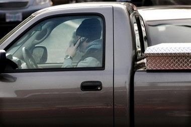 Fines could increase for using a hand-held cell phone in a car, under a bill that gets a hearing today in Salem.