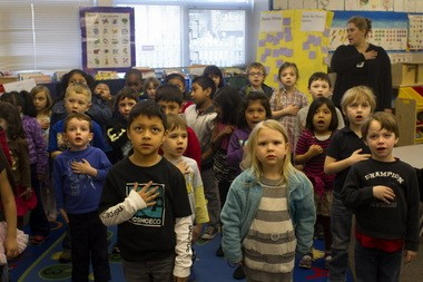 Kindergarten students at Metzger Elementary School in Tigard start the day by saying the Pledge of Allegiance in Spanish, part of an immersion program to teach fluency in both Spanish and English for all students.