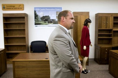 Rob Killgore, former administrator of Oregon Corrections Enterprises, is suing the state Corrections Department for $1.5 million over his firing. He is pictured here delivering inmate-built furniture to the Capitol in 2008.
