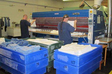 Inmates process prison laundry as part of job-creating projects of Oregon Corrections Enterprises. Mitch Morrow, deputy director of the Oregon Corrections Department, helped his son with pay issues after he was hired to help supervise laundry operations.