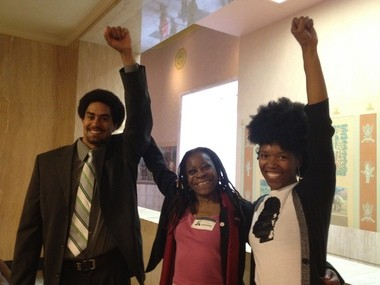 Ty Schwoeffermann (left) and Midge Purcell (center) of the Urban League of Portland celebrate the passage of House Bill 3409 with Portland resident Amber Starks. Starks practices natural hair care in Washington and lobbied her lawmakers, Rep. Alissa Keny-Guyer and Sen. Jackie Dingfelder, both Portland Democrats, to ease regulations on natural hair care.