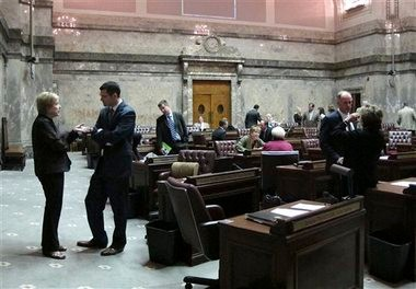 Washington state senators mill about on the Senate floor after passing a resolution to start a special legislative session May 13. Lawmakers have returned for a 30-day overtime session to finish work on the state budget. With just over a week left as of Monday, they have yet to reach a deal.
