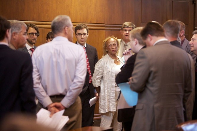 """Senate Republicans hold a """"water cooler"""" caucus near the back of the Senate chamber on the final day of the 2013 Oregon Legislature."""