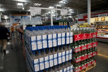 Liquor cases bulk up an aisle at a Costco in Vancouver, Wash. Theft of booze has become a law enforcement headache after voters privatized sales. In Oregon, which controls all sales, theft is almost nonexistent.