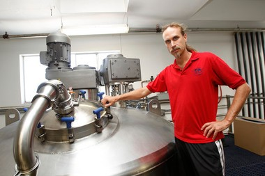 David Bronner, in a 2012 photograph, stands with a vat that feeds an assembly line for Dr. BronnerâÂÂs Magic Soap, which contains hemp oil as a key ingredient.