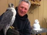 "Christopher Boyce, who prefers to be called Chris, agreed to pose with his falcon ""Higher Power"" and a little snowman at his home in the high-desert flats of central Oregon."