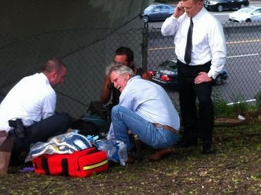 Gov. John Kitzhaber administers first aid Monday to a woman who overdosed on heroin in downtown Portland.