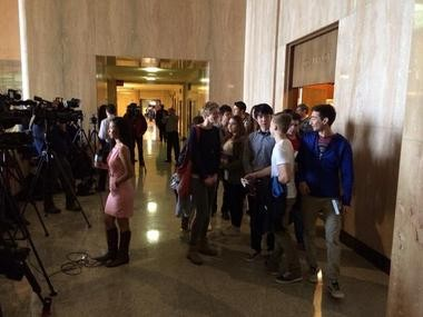Fifteen foreign exchange students tour the Oregon Capitol Friday. Cathy Ward, a retired teacher and chaperone, said they would use recent events as a teachable moment on how political power can change peacefully.