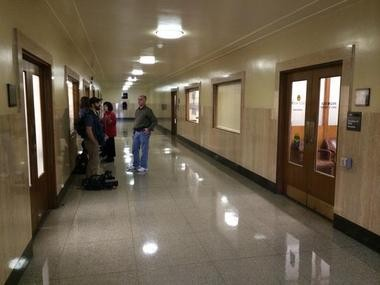 The scene outside Secretary of State Kate Brown's office was subdued Friday before Gov. John Kitzhaber's resignation.