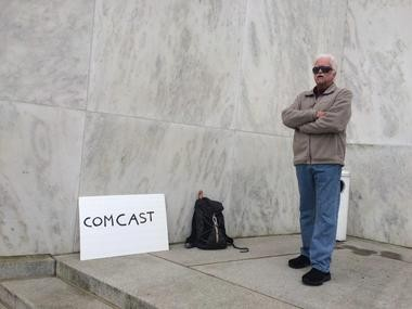 One protester outside the Oregon Capitol in Salem.