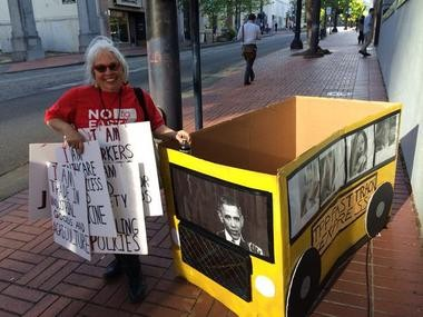 Rose Secrest, 62, spent nine hours making a cardboard bus to protest U.S. trade policy.