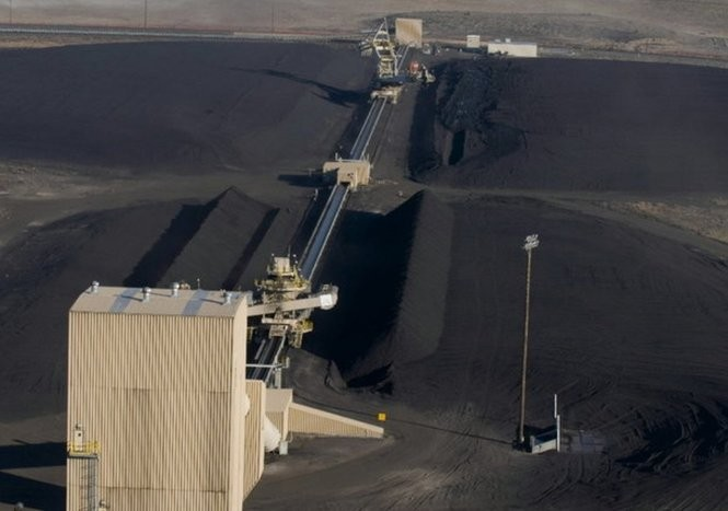 In this file photo from 2008, coal mined in Wyoming is piled at the power generating station in Boardman operated by Portland General Electric, which agreed to close the plant by 2020.