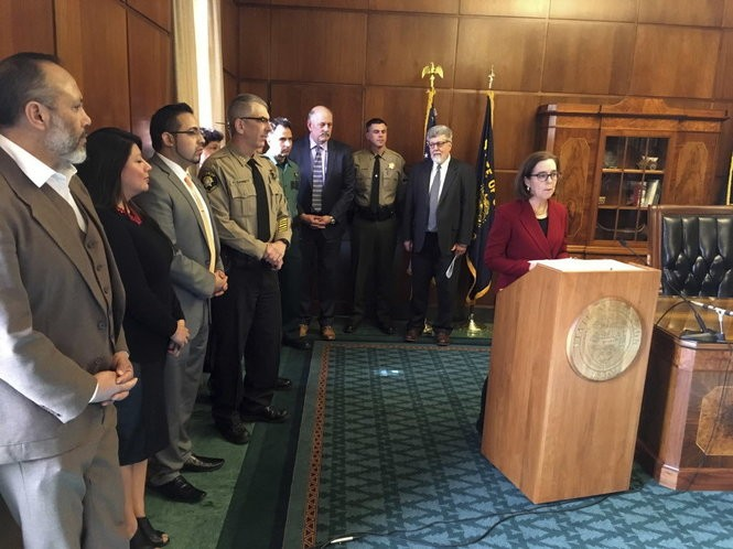 Oregon Gov. Kate Brown speaks during a press conference in the Capitol ceremonial office in Salem, Ore., Thursday, Feb. 2, 2017. Brown is asking Oregon's attorney general to bring legal action against the federal government over President Donald Trump's executive order on immigration.