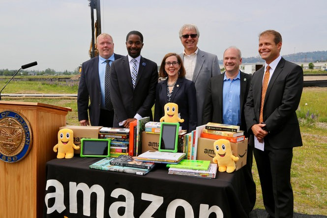 Leaders gathered at the future site of an Amazon fulfillment center in Troutdale on Wednesday, June, 7, 2017. Gov. Kate Brown is center, Troutdale City Councilor Larry Morgan is second from left and Troutdale Mayor Casey Ryan is far right.