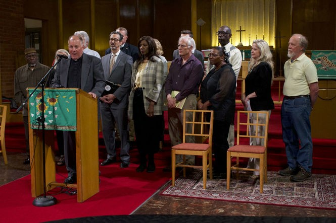 Rev. Mark Knutson, one of the chief petitioners of the gun control ballot measure, speaks at a press conference at Augustana Lutheran Church on Wednesday, June 6, 2018.