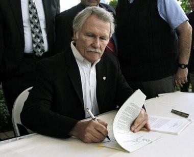 Oregon Gov. John Kitzhaber signed legislation creating the Oregon Health Insurance Exchange Corporation on July 1, 2011.