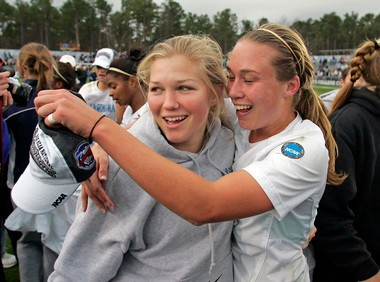 Elizabeth Guess (left) celebrates with Whitney Engen (right) after their Tar Heels team won the NCAA championship in 2006.