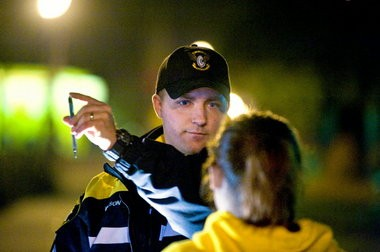 Deputy Josh Wilson of the Washington County Sheriff's Office checks a young woman for alcohol impairment after making a traffic stop in December of 2009.