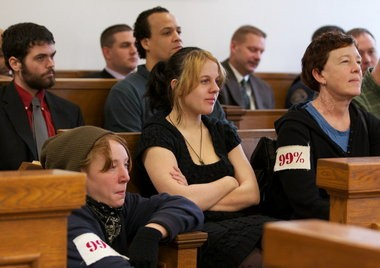 Liz Nichols (center) sits in a Multnomah County Courtroom during a court hearing after she was involved in protests in Portland.