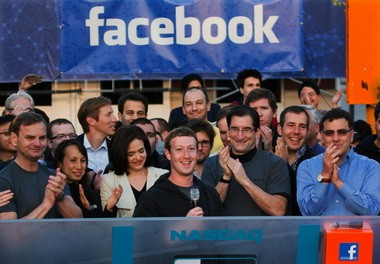 Facebook founder, Chairman and CEO Mark Zuckerberg, center, rings the Nasdaq opening bell from Facebook headquarters in Menlo Park, Calif., last May.