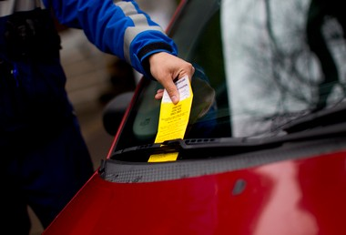 Alexandru Firica, who has been working as a parking enforcement officer in Portland for a little over a year, doled out a few parking tickets while walking the Park Blocks Monday afternoon in downtown Portland.