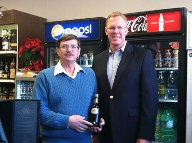 Lyle Schellenberg, left, recently bought a $27,000 bottle of Glenfiddich scotch at Southwest Portland's Hillsdale Liquor, owned by Bruce Randall, right.