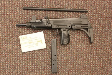 Portland police arrest man accused of carrying an Uzi concealed in
