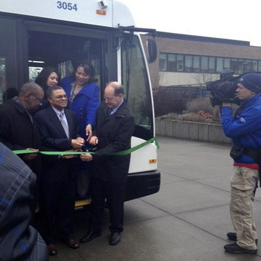 (Clockwise from left) TriMet board member Rev. T. Allen Bethel, Latino Network executive director Carmen Rubio, Multnomah County Commissioner Loretta Smith, TriMet general manager Neil McFarlane and PCC-Cascade president Algie Gatewood cut the ribbon to launch TriMet's new hybrid buses.