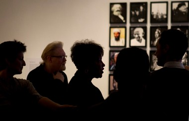 """Artist Carrie Mae Weems talks to people during a preview of her new exhibit """"Carrie Mae Weems: Three Decades of Photography and Video,"""" at the Portland Art Museum, Feb. 2 to May 19. Over 30 years Weems has explored universal topics in her images primarily of black subjects."""