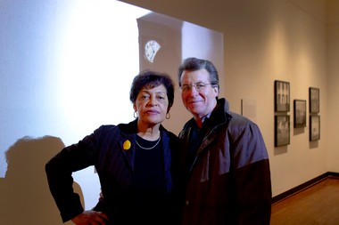 """Artist Carrie Mae Weems with husband Jeffrey Hoone, in her exhibit space at the Portland Art Museum. The exhibit, """"Carrie Mae Weems: Three Decades of Photography and Video,"""" presents more than 200 photographs, videos, and installations tracing the evolution of Weems' career. The show runs from through May 19."""
