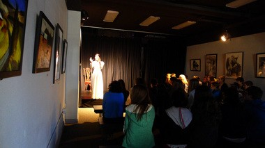 """Galatea Swart, a 17-year-old Northwest Academy student, performs the one-woman play, """"The Belle of Amherst,"""" about Emily Dickinson in the Angry Pigeon Gallery in front of a middle school class. Swart will perform a portion of the play Friday evening, when the school's gallery will now be open to the public."""