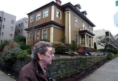 Mike Ryerson tells the history behind a regal house -- now a law office -- at 2210 N.W. Flanders St. Ryerson is a lifelong Northwest Portland resident known for his history tours with McMenamins. Since he left the NW Examiner weekly last month, he has started his own tour of the Nob Hill neighborhood.