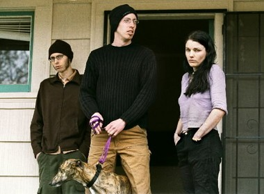 Craig Rosebraugh (center), with Leslie James Pickering and Elaine Close, returned to their Portland home after the FBI served search warrants there in April 2001, hauling off computers and other electronic gear for the second time in a year.