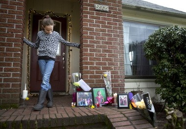 Jaylynn Ruiz, an older sister of Morgan Maynard-Cook, stands on the front porch of their home the day after Morgan was killed. The 5-year-old died after being struck by a car near the corner of Southeast 136th Avenue and Harold Street, just outside her home. Neighbors and friends had begun dropping off photos and flowers as a tribute to Morgan.
