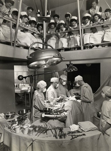 Student nurses observe a surgery at Multnomah County hospital, circa 1945.