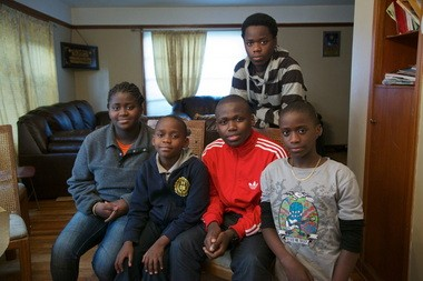 The family faces a challenging future after the death of their mother earlier this month. From left: Shamsi Omari, 14; Amissi Omari, 9; Hussein Omari, 19; Ramazani Omari, 16 (standing) and Mussa Amissi, 12. A sixth sibling, Amida Omari, 18, hadn't returned from school in time for the family portrait Thursday.