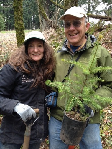 Susan Hawes, of Portland Parks & Recreation, and Friends of Mt. Tabor volunteer Darvel Lloyd replanted a Doug Fir sapling Tuesday.
