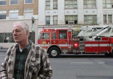 Carl Sizelove, 52, said he was in his downtown Portland apartment Monday when he searched for the source of fire alarms and found smoke pouring out of a room two floors below. He extinguished the flames and helped a 55-year-old tenant inside escape.