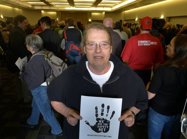 Ron Deason, 57, holds the symbol of support for the We Are the Safety Net campaign, revived for a second time this fiscal year as more than 50 organizations that serve low-income and homeless people fight to maintain the Portland Housing Bureau's funding. Deason was among those to testify at a City Council budget hearing last week.