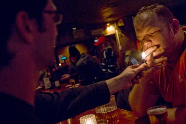 Victor Albee, who was a regular at Joe's Cellar, spends a Monday night there with some friends, including Jason Simmons, left, in this 2008 photo -- before the smoking ban. Joe's kept regulars for decades; one Portland lawyer's family even noted the restaurant and lounge among their late father's favorite things in his 2007 obituary.