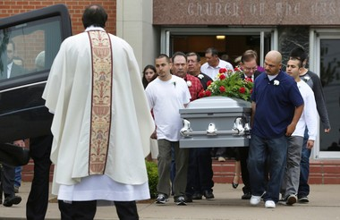 Pallbearers carry the casket of Mariano C. Saldivar, 57, who was killed by the blast in West, TX, in his apartment which was close to the explosion.  Bob Owen/San Antonio Express-News