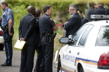 Police Chief Mike Reese, left, consults with then-Mayor Sam Adams, right, along Southwest Naito Parkway shortly after Officer Dane Reister mistakenly fired his beanbag shotgun loaded with lethal rounds at 20-year-old William Kyle Monroe on June 30, 2011.