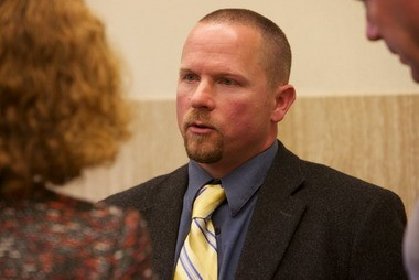 Portland Police officer Dane Reister talks to his attorney Janet Hoffman in May 2012.