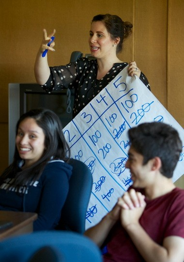 Franklin High students play a Jeopardy-like Q and A game on job interviewing. Alyssa White, with Impact NW, answers a question about the game. In the foreground are Marian Vazquez, left, 17, and Antonio Crosier, 16.