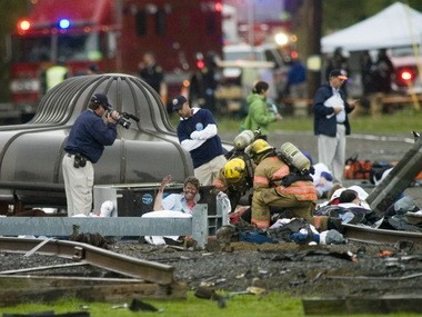The U. S. Department of Homeland Security conducted a full scale simulated terrorist attack conducted at Portland International Raceway in October 2007. The event called Top Officials Exercise or, TOPOFF 4, was based on a detonation of a dirty bomb in Portland. Here, officials document firefighters assisting injured persons. A similar drill will unfold over three days starting Tuesday.