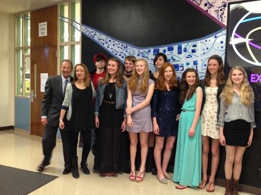 Alexander and Jamie Bernstein (far left) pose for photos with Jackson Middle School students in front of a glass installation recently completed by some of the school's students. The son and daughter of composer Leonard Bernstein were at the school to celebrate 15 years of its participation in the Bernstein Artful Learning Program.