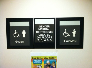 New signs in Multnomah County's headquarters in Southeast Portland direct employees and visitors to gender-neutral bathrooms designed to ease fears among transgender users.